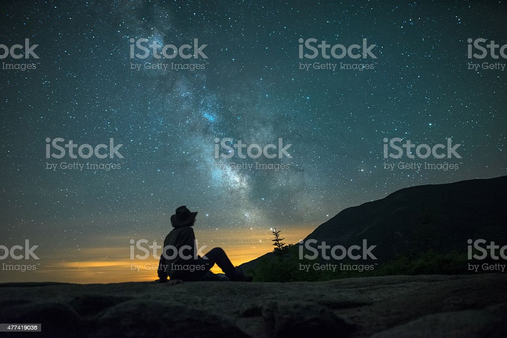 Man looking at the Milky Way galaxy in Crawford Notch stock photo