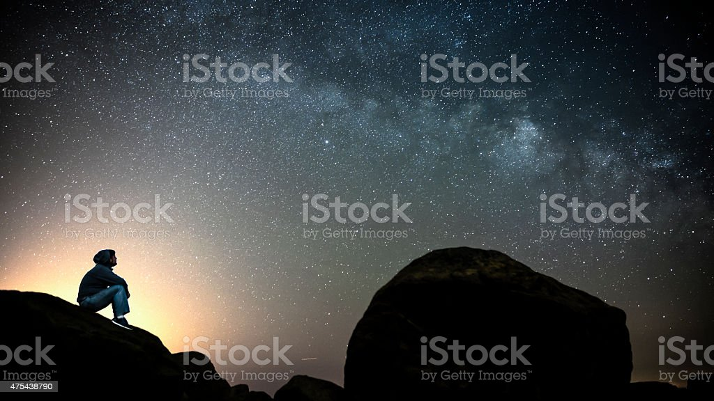 Man looking at the Milky Way galaxy stock photo