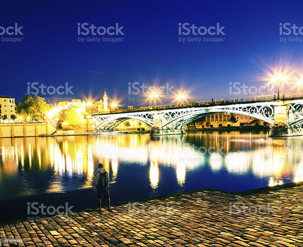 Man looking at the Triana Bridge, Seville, Spain royalty-free stock photo