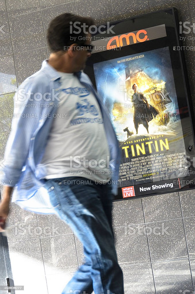 Man Looking at Tintin Movie Poster stock photo