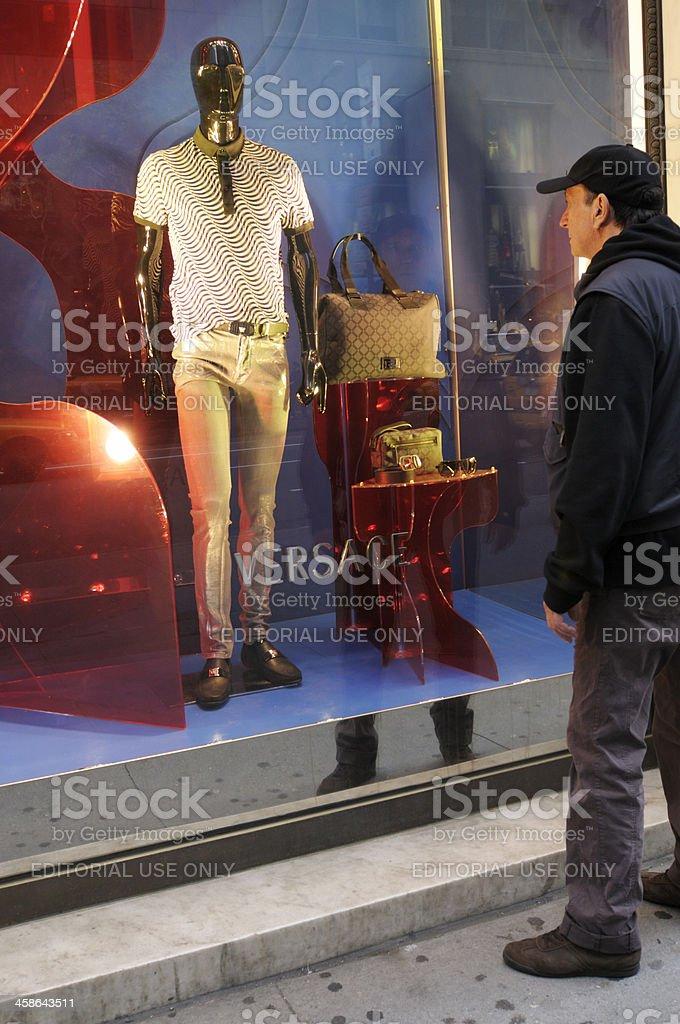 Man Looking at Window Display.NYC. stock photo