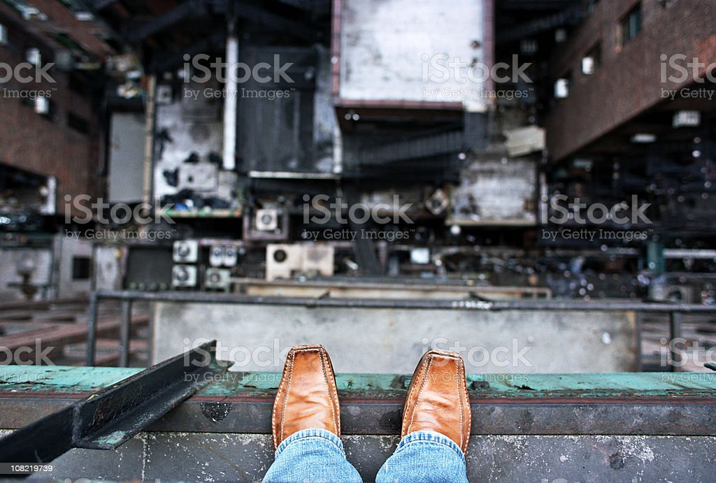 Man Looking Down From a High Ledge - Suicide Concept stock photo