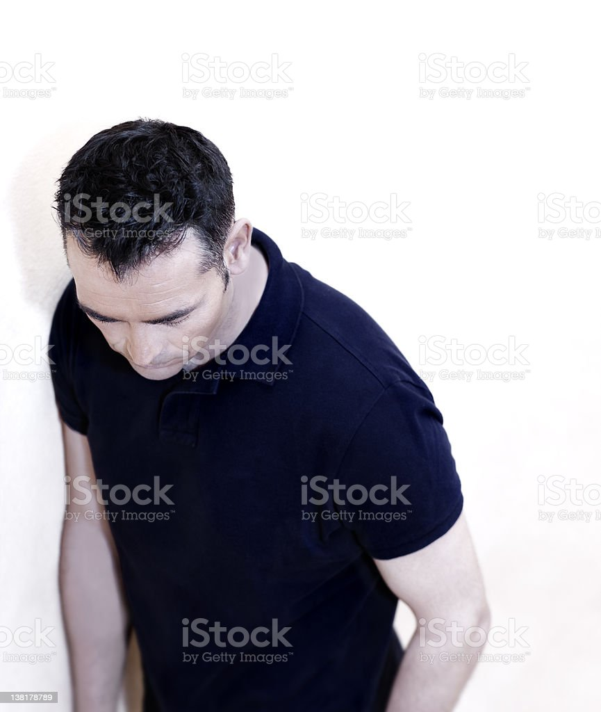 Man looking down frustrated royalty-free stock photo