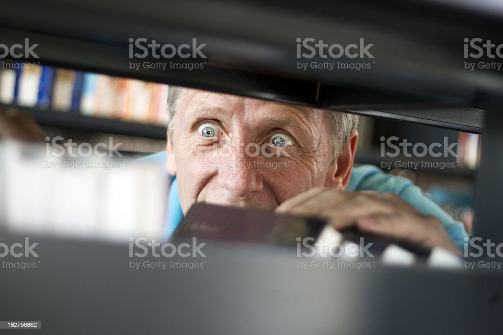 Man Looking for a Book royalty-free stock photo