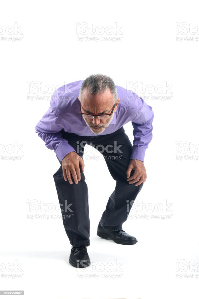 Man looking for a thing he has lost stock photo