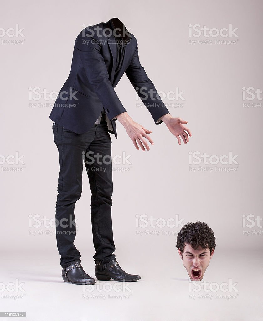 Man looking for his head stock photo