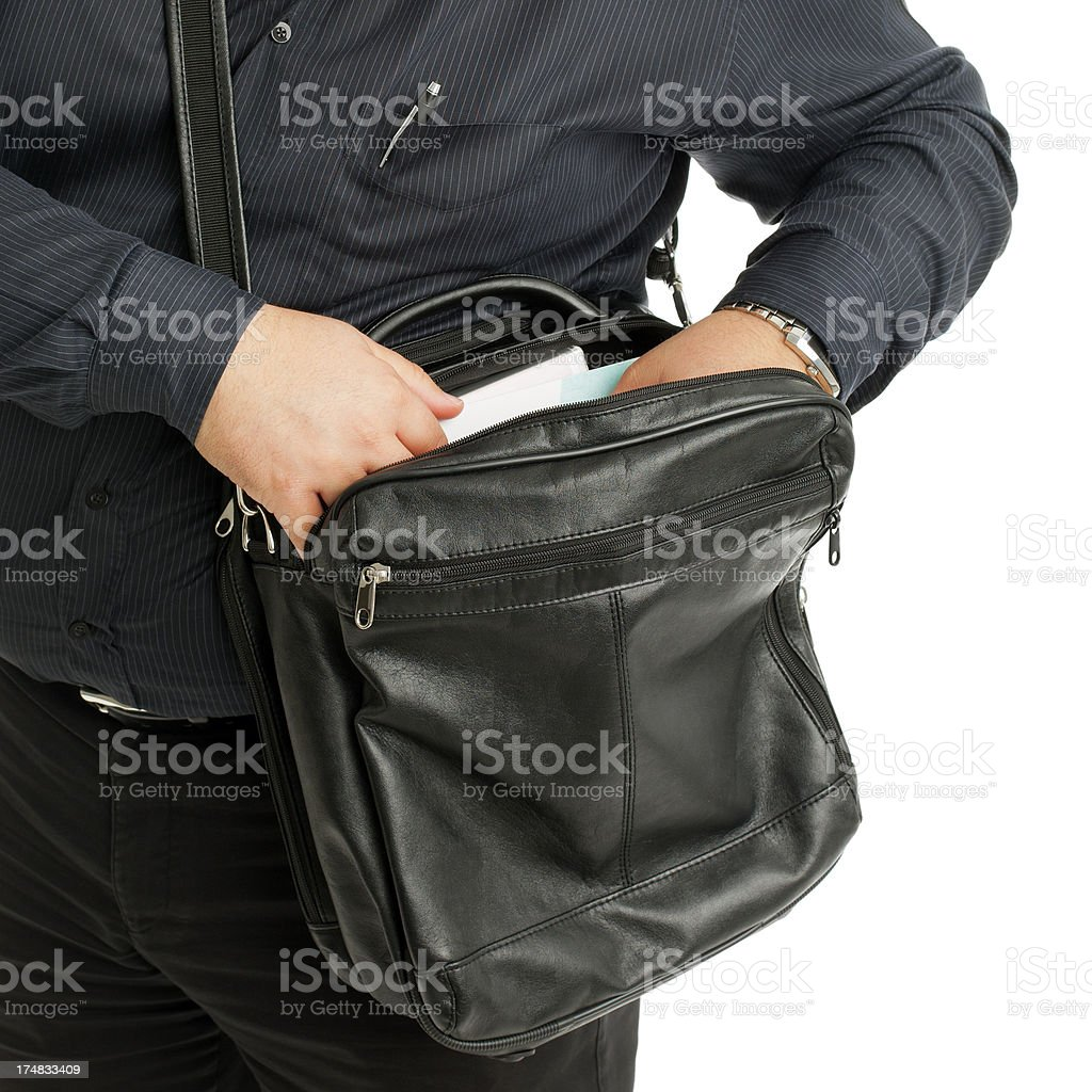 Man looking for some documents in his bag stock photo