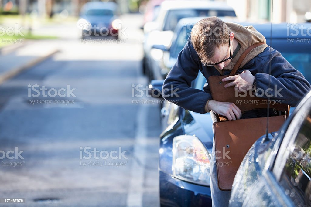 Man looking in bag royalty-free stock photo