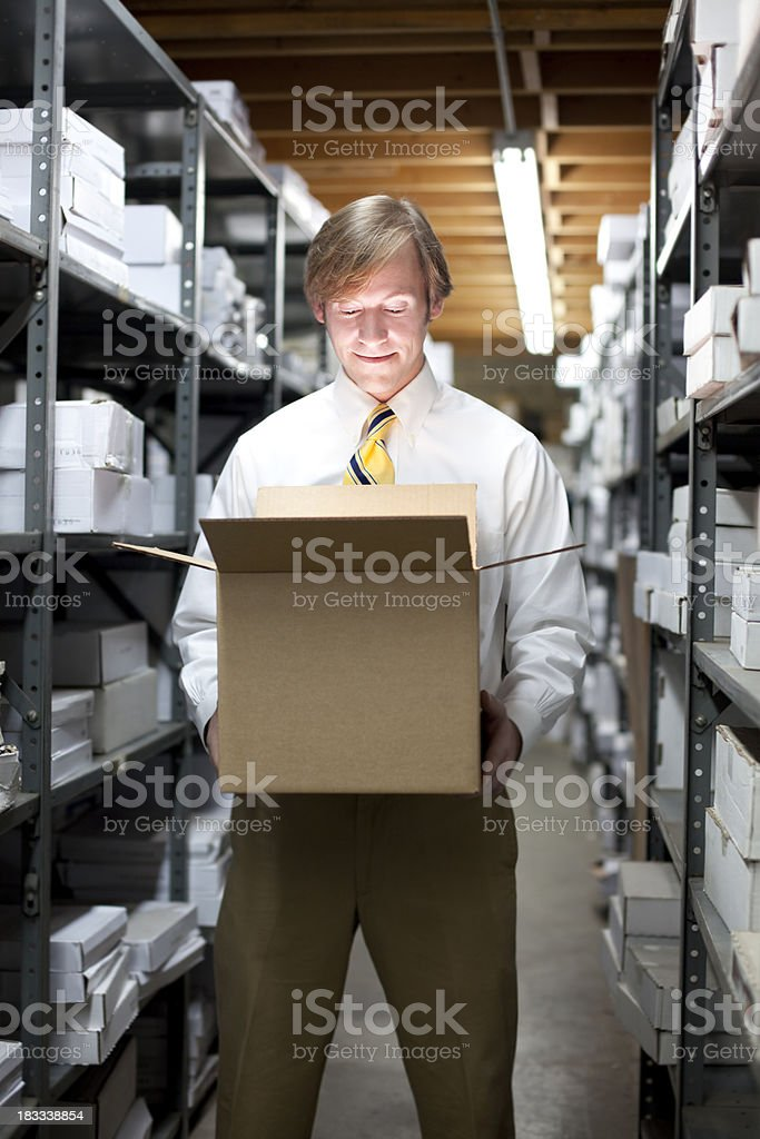 Man Looking in Box royalty-free stock photo