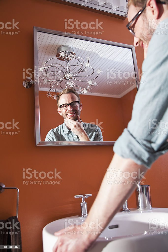 Man looking in mirror stock photo