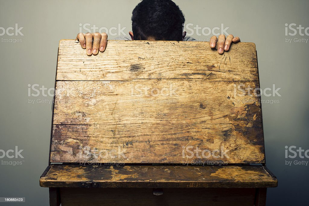Man looking inside old school desk royalty-free stock photo