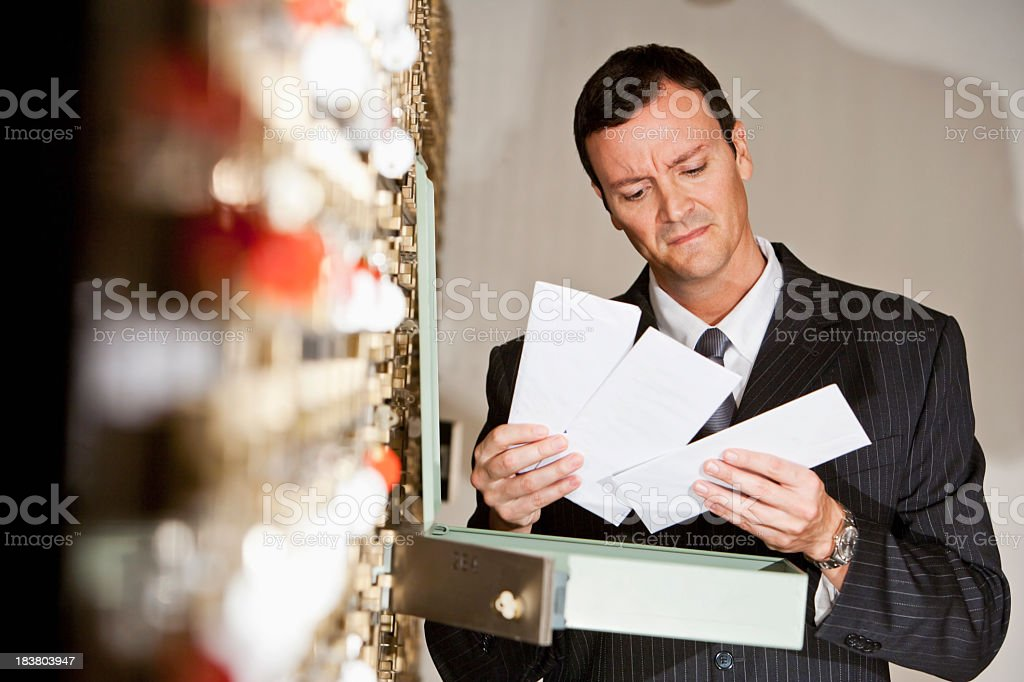 Man looking inside safety deposit box royalty-free stock photo