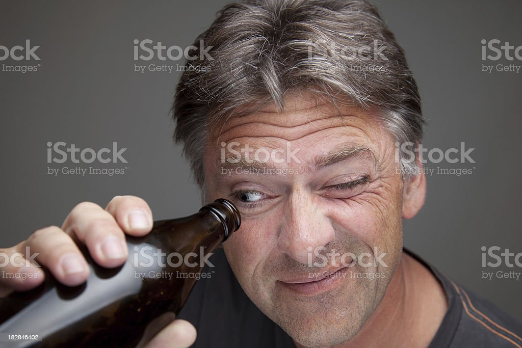 man looking into  the bottle stock photo