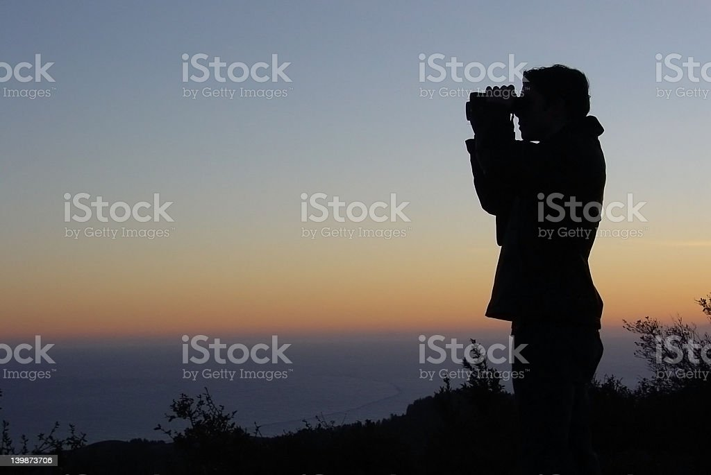 Man Looking Out Across the Ocean stock photo