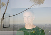 Man looking out living room window
