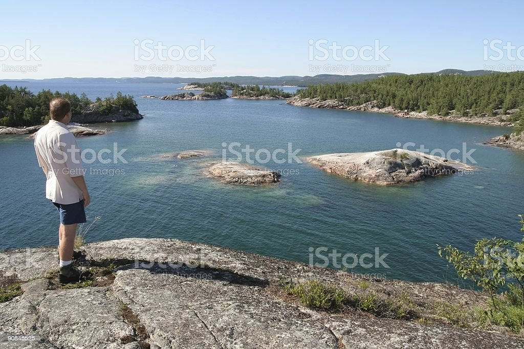 Man Looking Out Over Lake Superior royalty-free stock photo