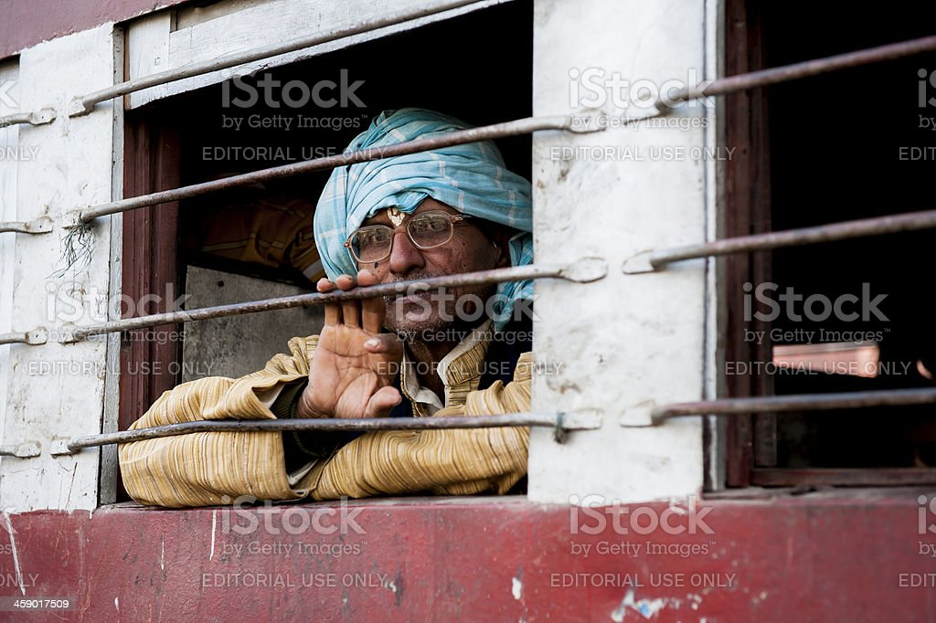 Man looking outside the window of train stock photo