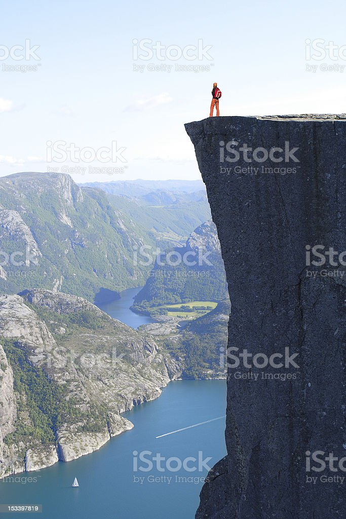 A man looking over a cliff in Preikestolen  royalty-free stock photo