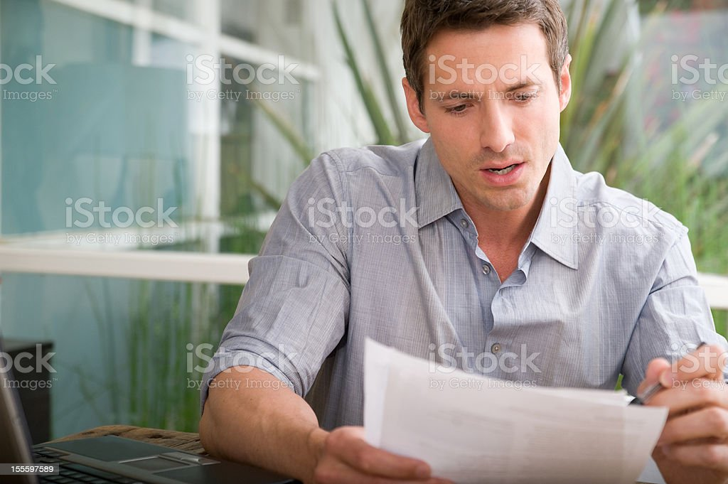 Man looking over papers royalty-free stock photo