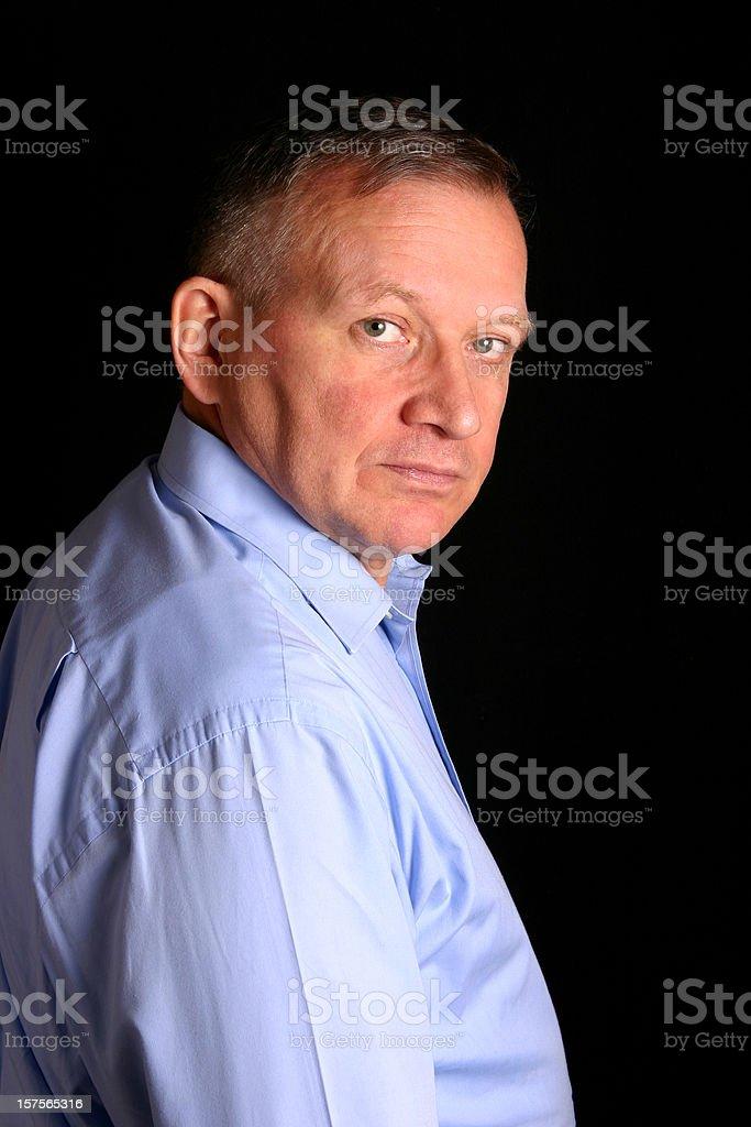 Man looking over shoulder stock photo