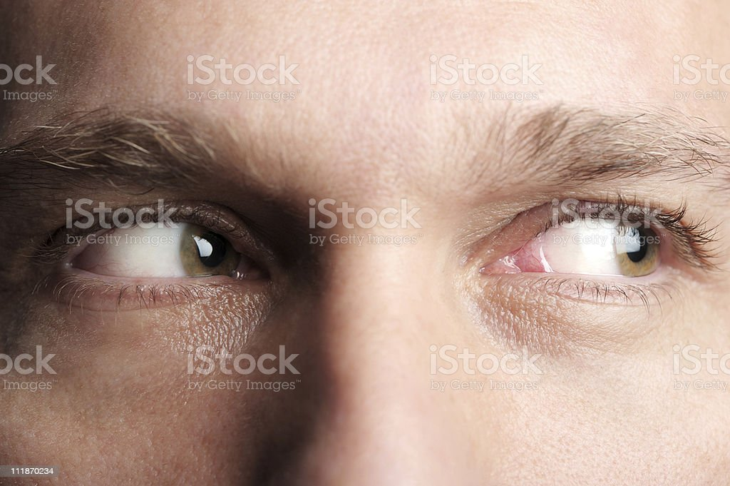 Man Looking Sideways Extreme Close Up on Eyes royalty-free stock photo