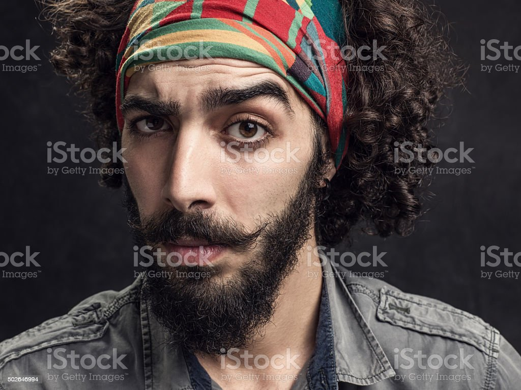 Man looking suspiciously at the camera stock photo