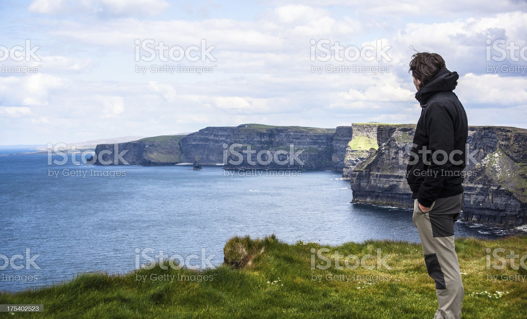 Man Looking the Cliffs of Moher in Ireland royalty-free stock photo