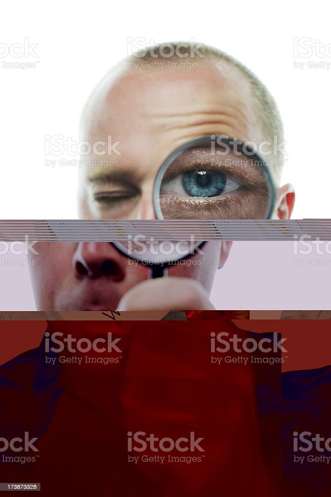 Man looking through a magnifying glass royalty-free stock photo