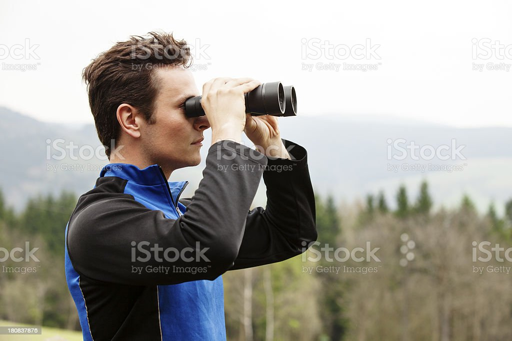 Man Looking Through Binoculars royalty-free stock photo