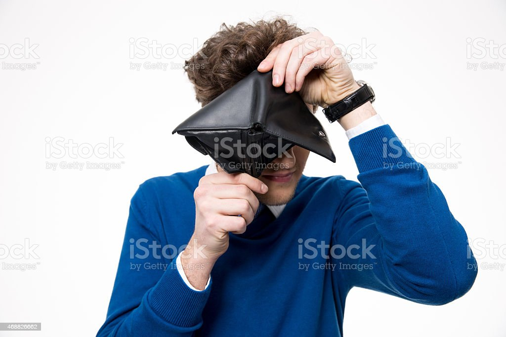 man looking through empty wallet stock photo