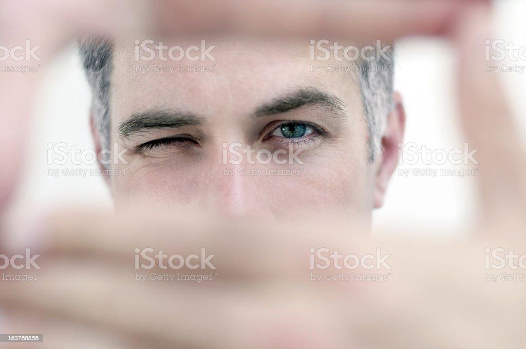 Man looking through hands in a rectangular shape stock photo