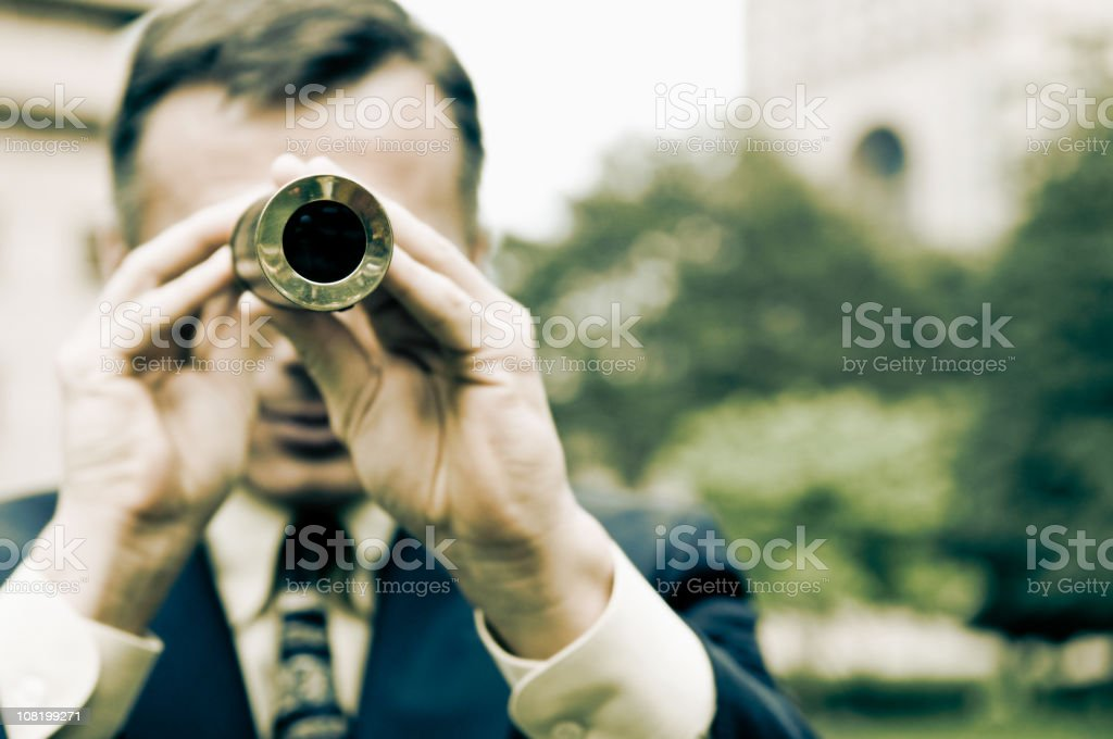 Man Looking Through Telescope royalty-free stock photo