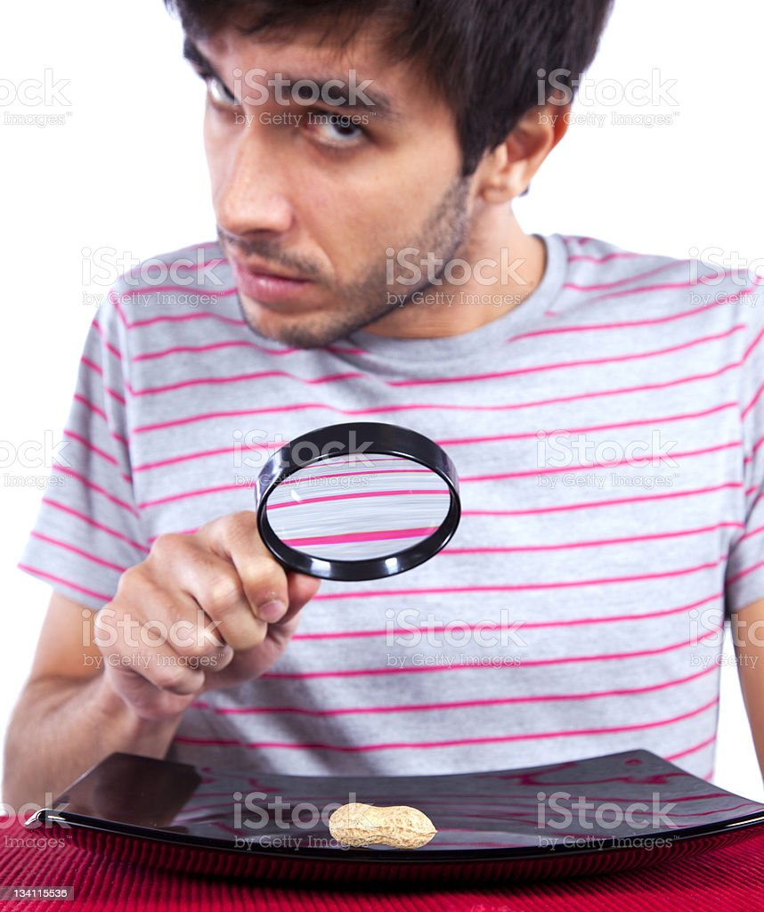 Man looking to a peanut royalty-free stock photo