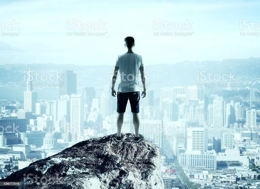 man looking to city stock photo