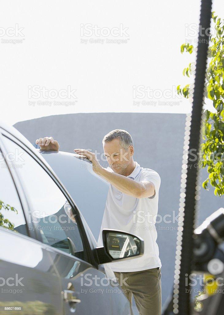 Man looking underneath car hood royalty-free stock photo