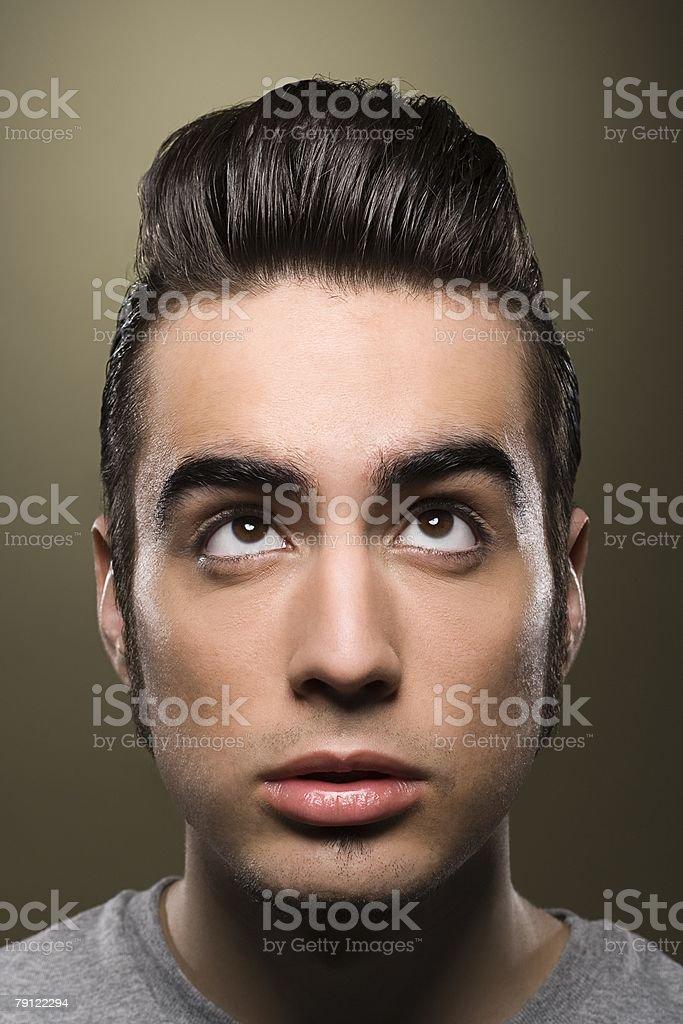 Man looking up at his hair stock photo