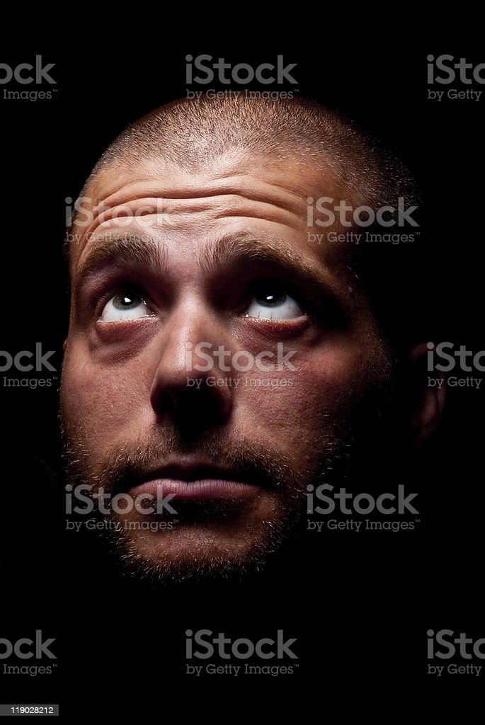 Man looking up into the dark. royalty-free stock photo