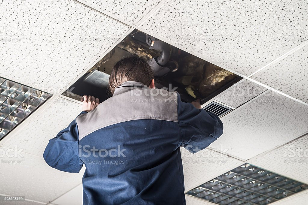 man looking up the ceiling stock photo