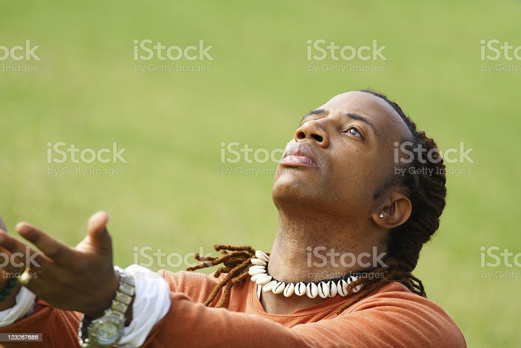 Man looking up with Hands Extended stock photo