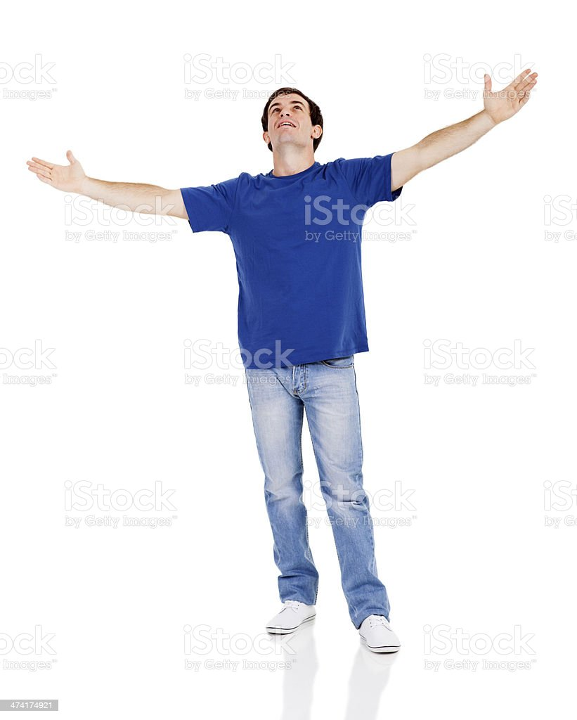 man looking up with his arms wide open stock photo
