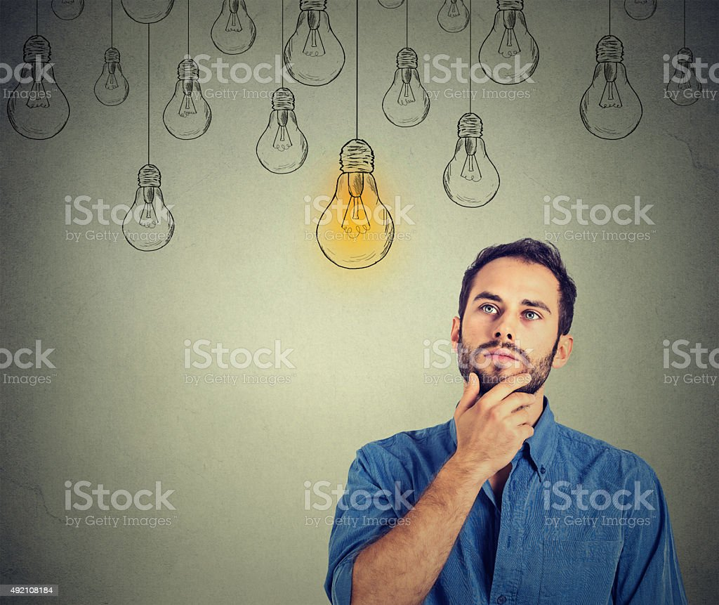 man looking up with idea light bulb above head stock photo