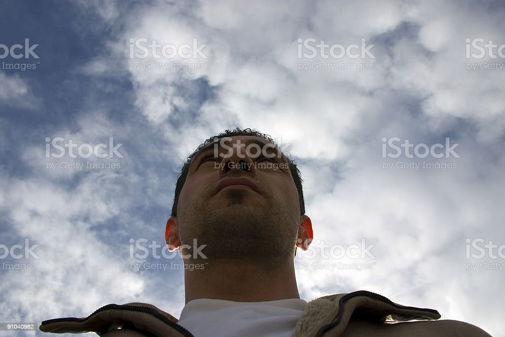 Man Looking up with the Clouds on Background royalty-free stock photo
