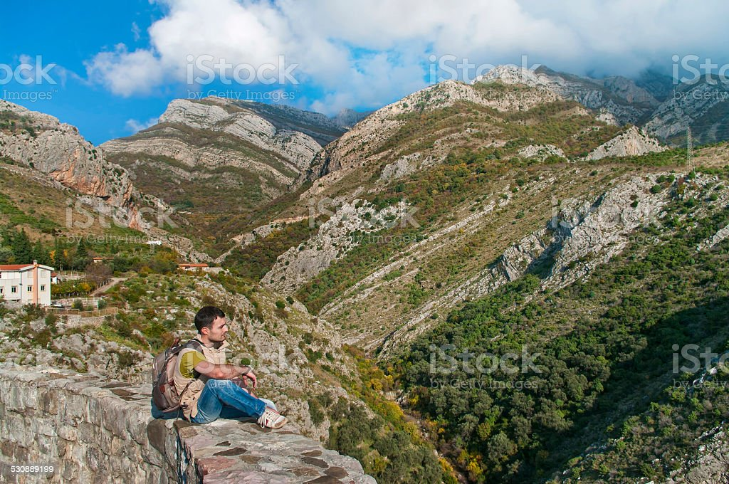 man lookng at mountains stock photo