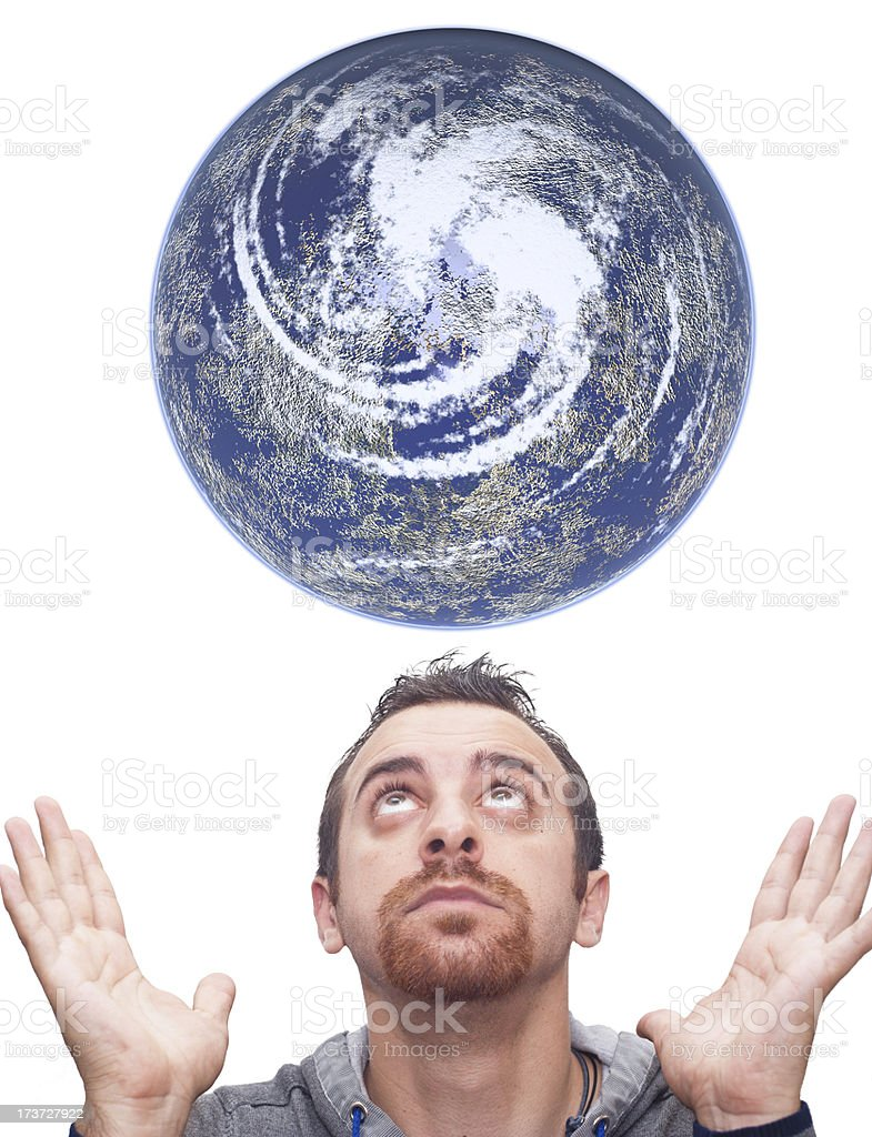 Man looks at the planet earth stock photo