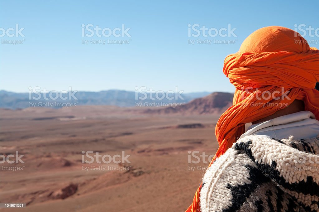 Man looks out at wilderness on edge of Sahara Desert royalty-free stock photo