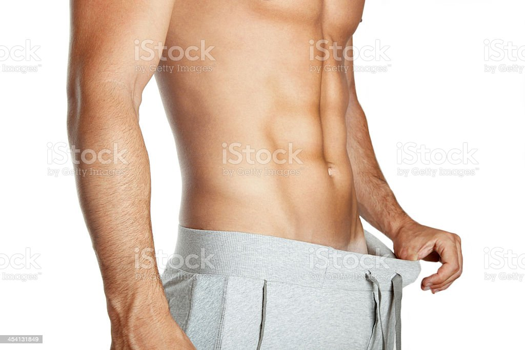 Man lost weight, diet, abdominals, keep fit, isolated on white royalty-free stock photo