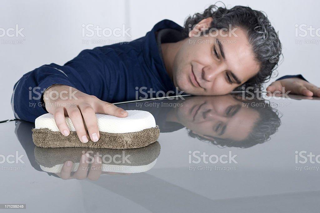 Man Lovingly Polishing His Car royalty-free stock photo