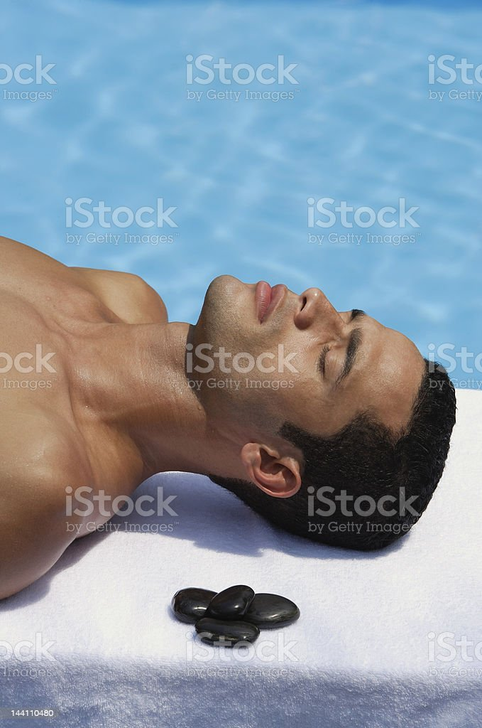 man lying by pool royalty-free stock photo