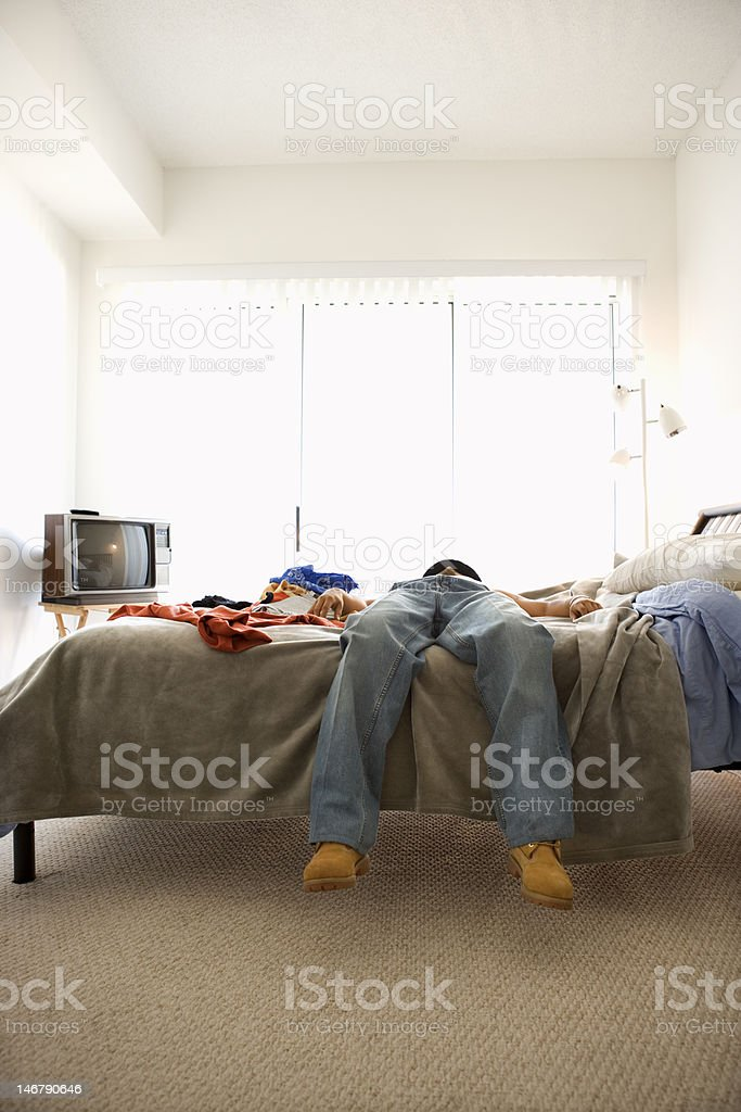 Man Lying on Bed stock photo