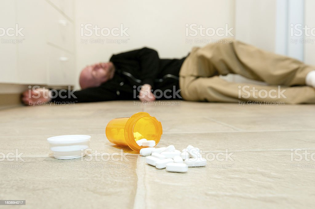 Man lying on the floor after a drug overdose stock photo